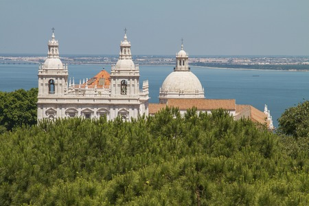 portugese: Church of Santa Engracia, Lisbon, Portugal with the ocean in background