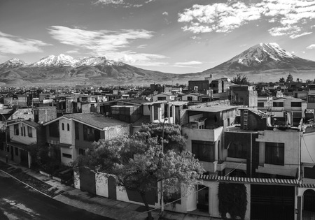 volcanos: City of Arequipa with its iconic active volcanos of Misti and Chachani, Peru Stock Photo