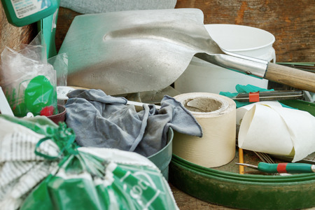 cluttered: Cluttered and messy storage of garden tools  for diy projects