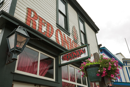 SKAGWAY, ALASKA, USA - SEPTEMBER 20 - The Red Onion Saloon is open to cruise ship tourists. This historic saloon opened in 1898 as a bar and brothel catering to gold rush miners.