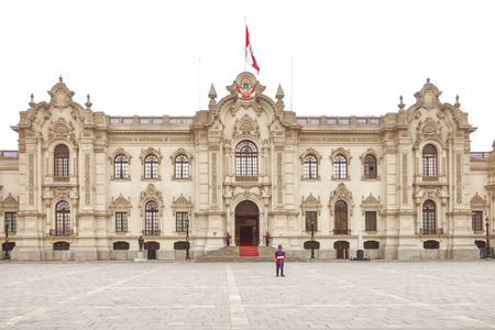 pizarro: LIMA, PERU - OCTOBER 31, 2011: Government palace with guards at Plaza de Armas in Lima, Peru. It is the birthplace of the city of Lima, as well as the core of the city. Located in the Historic Centre of Lima.