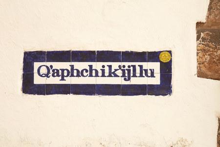 quechua: Street sign written in quechua in the old town of Cusco Peru