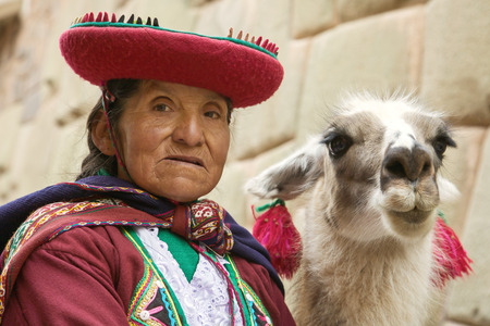quechua: Portrait of old peruvian quechua woman in traditional clothes with llama in Cusco