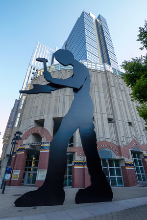 mechanical works: Artwork of The Hammering Man by Jonathan Borofsky, Stands Outside the Seattle Art Museum in Washington, United States.