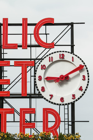 pike place: Sign and Clock of the Famous Pike Place Market in Seattle, United States.