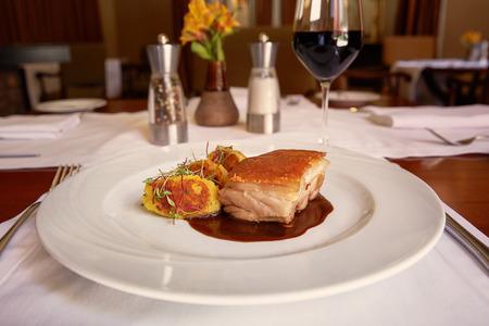Traditional Peruvian Meal Called Chicharron de Panceta de Cerdo Served in a Restaurant. Stock Photo