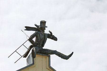 KLAIPEDA, LITHUANIA - JULY 05, 2017: Chimney Sweeper Sculpture on roof in old town of Klaipeda, Lithuania.