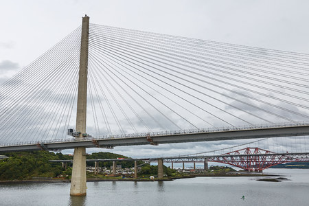 The new Queensferry Crossing bridge over the Firth of Forth with the older Forth Road bridge and the iconic Forth Rail Bridge in Edinburgh Scotland