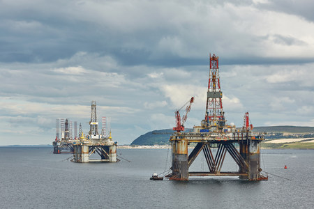 INVERGORDON, UK - AUGUST 07: Large offshore oil rig drilling platforms off the coastline near Invergordon in Scotland Editorial