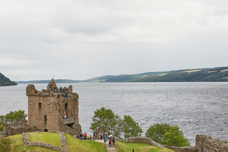 INVERNESS, SCOTLAND - AUGUST 07, 2017: People enjoying vist at Urquhart Castle on the Shore of Loch Ness, Scotland