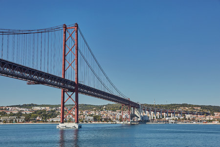 The 25 April bridge (Ponte 25 de Abril) is a steel suspension bridge located in Lisbon, Portugal, crossing the Tagus river. It is one of the most famous landmarks of the region Stock Photo - 123490420