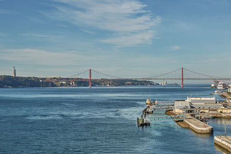 The 25 April bridge (Ponte 25 de Abril) is a steel suspension bridge located in Lisbon, Portugal, crossing the Tagus river. It is one of the most famous landmarks of the region Stock Photo