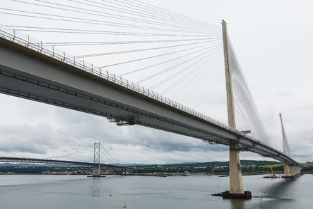The new Queensferry Crossing bridge over the Firth of Forth with the older Forth Road bridge in Edinburgh Scotland Stock Photo