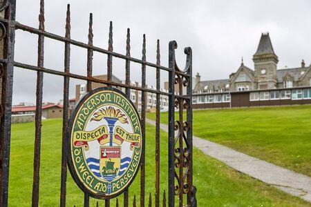 LERWICK, SHETLAND ISLANDS, SCOTLAND, UK -  AUGUST 20, 2017: Painted sign on metal doors as entrance into Anderson High School in Lerwick, Shetland Islands, Scotland, UK 報道画像