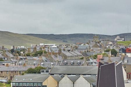 Lerwick town center under cloudy sky, Lerwick, Shetland Islands, Scotland, United Kingdom Stock Photo