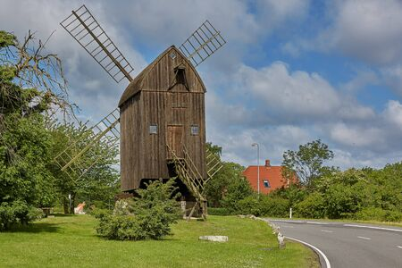 Timbered post mill built in 1629 - the oldest preserved windmill in Denmark, Svaneke, Bornholm island. Stock Photo