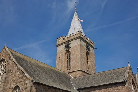 The Town Church is also known as the Parish Church of St Peter Port in Guernsey during Sunny day with blue sky.