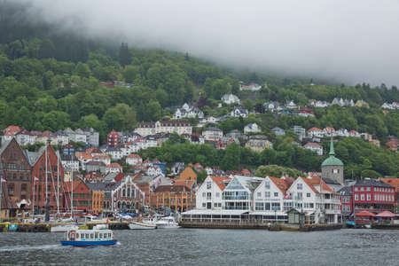 Old hansaetic wooden houses built in row at wharf of Bergen fjord are UNESCO World Heritage site and very popular for turists Sajtókép