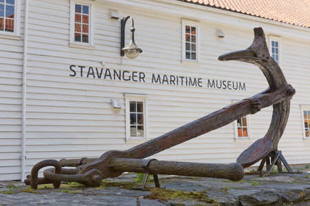 STAVANGER, NORWAY - JUNE 01, 2017: An old anchor displayed in front of Stavanger Maritime Museum entrance in Stavanger Norway.