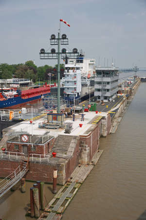 Kiel, Germany - May 23, 2017: Cruise ship passes the Holtenau lock of the Kiel Canal to continue their journey to the Baltic Sea