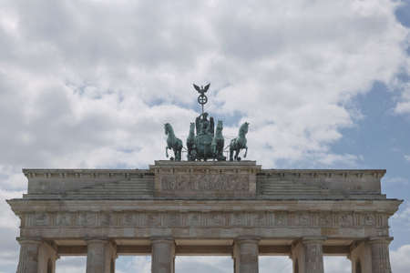 Berlin, Germany - July 13, 2017: Brandenburg gate in Berlin, Germany. Architectural monument in historic center of Berlin. Symbol and monument of architecture. Sajtókép