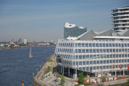 Hamburg, Germany - May 22, 2017: Hafencity Unilever headquarter and Marco Polo Tower residential apartments, located by the river Elbe in the port of Hamburg in Germany. 新闻类图片