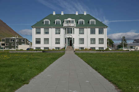 Isafjordur, Iceland - July 28, 2017: Safnahusid in Isafjordur in Iceland was built as a hospital in 1925 but now houses a library, a record office, an art museum and a photographic archive.