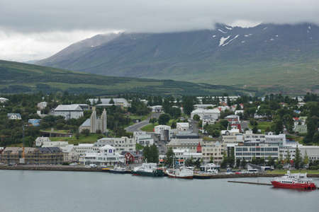 Akureyri, Iceland - July 27, 2017: View of a city center and Akureyrarkirkja church in Akureyri in Iceland. Editorial