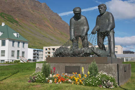 Isafjordur, Iceland - July 28, 2017: The Fisherman's Monument is a sculpture in Isafjordur, a town in Northern Iceland. It commemorates those mariners who drowned at sea.