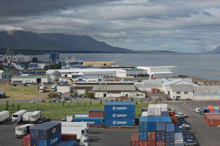 Akureyri, Iceland - July 27, 2017: Trucks and containers ready for transportation at port of Akureyri in Iceland. Editorial