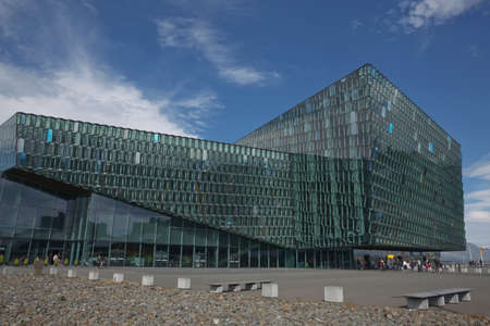 Reykjavik, Iceland - July 29, 2017: Award-winning Harpa Concert hall and Conference Center in Reykjavik in Iceland has a glass facade made up of geometric shapes that change color with light of day Editorial