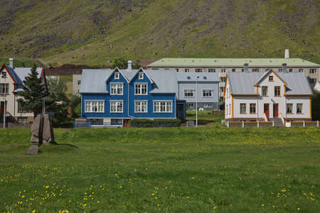 Isafjordur, Iceland - July 28, 2017: Traditional style houses that overlook the Tungata square in beautiful town of Isafjordur in Iceland.