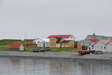 Vigur Island, Iceland - August 24, 2017: Houses and boat in front of the beach in Vigur island, Iceland.