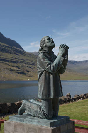 Eskifjodur, Iceland - August 08, 2017: An iconic statue in Eskifjodur, the statue dedicated to victims of sea in Eastern Iceland.