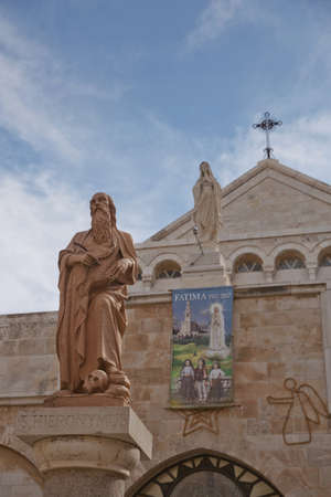 Bethlehem, Palestine, Israel - October 24, 2017: A statue of Saint Hieronymus outside The Church of the Nativity which is a basilica located in the West Bank of Bethlehem.