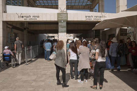 Jerusalem, Israel - October 23, 2017: People entering the Western 'Wailing' Wall of Ancient Temple in Jerusalem. The Wall is the most sacred place for all jews in the world.