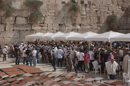 Western wall, Jerusalem, Israel - October 23, 2017: A lot of people gathered together to celebrate and pray in front of the wall.