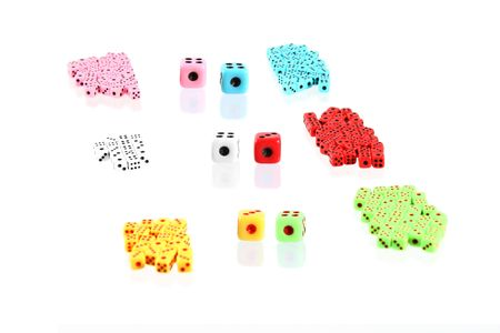 a lot of colorful playing dices (may symbolized teams with  leaders) Stock Photo - 2740271