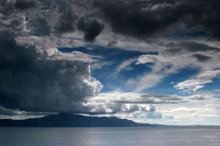 Cloudy weather above the sea Stock Photo