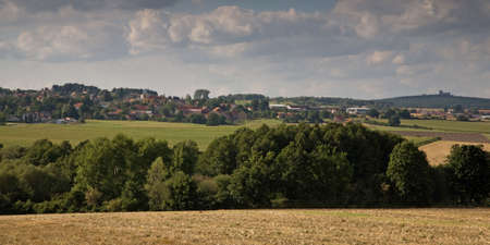 Czech landscape with village and ruin of castle