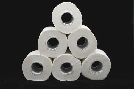 a lot of toilet papers on black background Stock Photo - 2739926