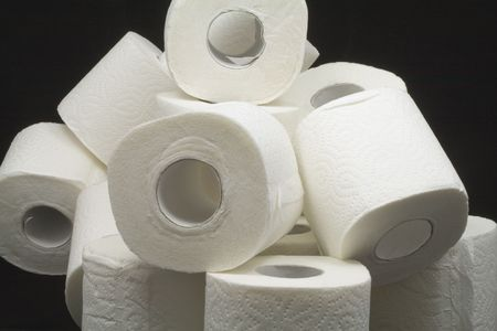 hemorrhoids: a lot of toilet papers on black background Stock Photo