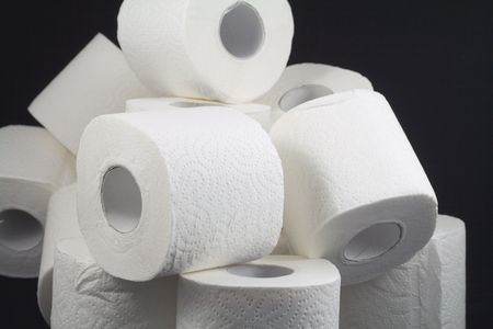 a lot of toilet papers on black background Stock Photo - 2739947