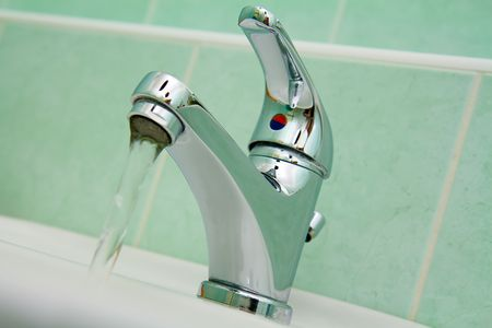 chrome water faucet in bathroom photo