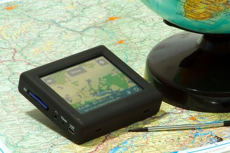 gps navigation on a map and globe Stock Photo