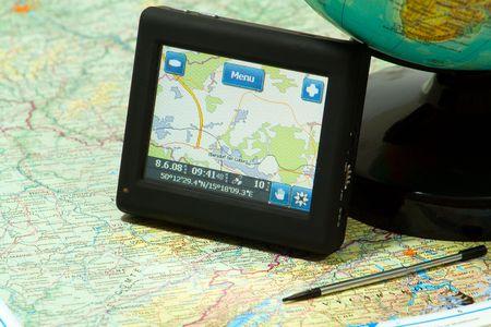 gps navigation on a map and globe photo