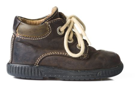 brown child shoe on white background photo