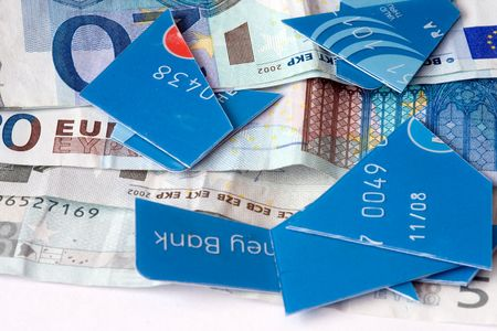 cut up credit card with money photo