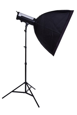 studio strobe with softbox on white background photo