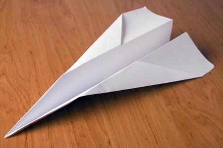 white paper plane on table Stock Photo - 4564044